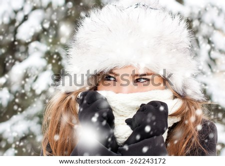 Portrait of a young beautiful woman in snowy weather. - stock photo