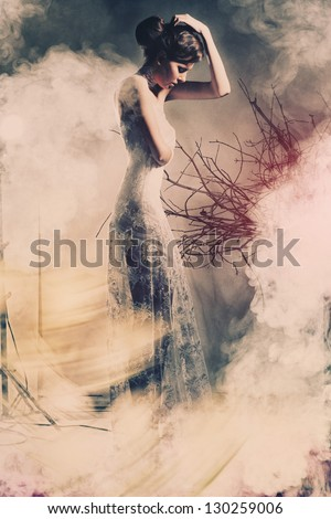 Portrait of a young beautiful woman in the wedding with the smoke - stock photo