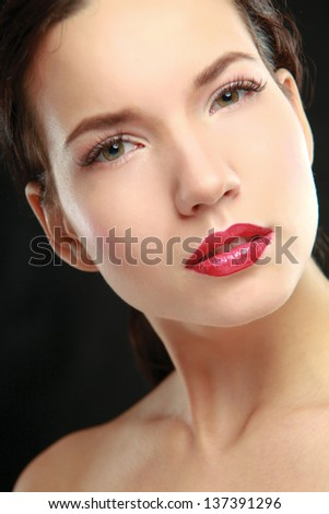 Portrait of a young beautiful woman, isolated on black background - stock photo