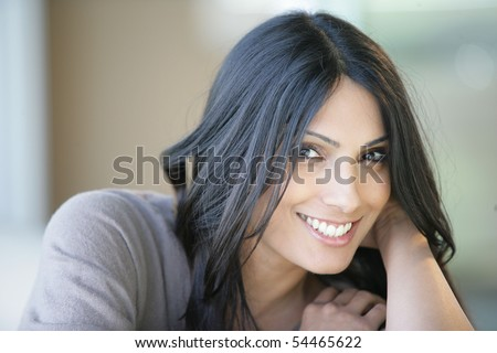 Portrait of a young beautiful woman smiling - stock photo