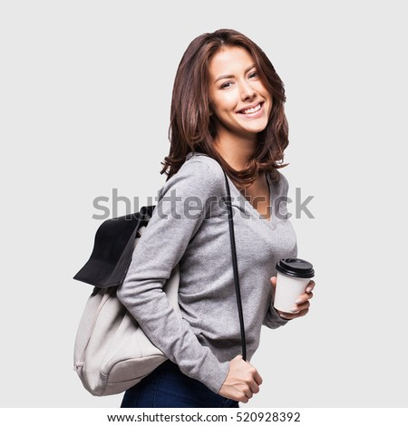 Portrait of a young beautiful woman with a cup of coffee