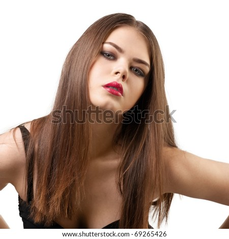 Portrait of a young beautiful woman with make-up looking at camera against white background - stock photo