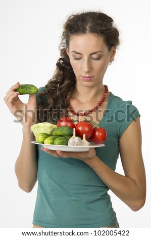 Portrait of a young beautiful woman with vegetables closeup