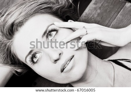 Portrait of a young beauty in black and white tones - stock photo