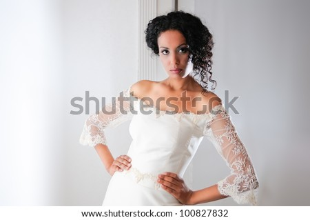 Portrait of a Young black woman, model of fashion, wearing a wedding dress