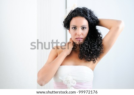 Portrait of a Young black woman, model of fashion with afro hairstyle, wearing a wedding dress - stock photo
