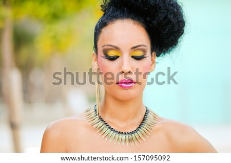 Portrait of a young black woman, model of fashion, with fantasy make up made by a professional beautician - stock photo