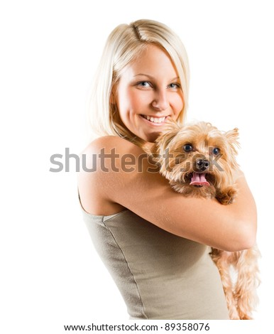Portrait of a young blond holding her pet dog isolated on white background. - stock photo