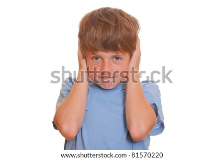 Portrait of a young boy covering his ears on white background - stock photo
