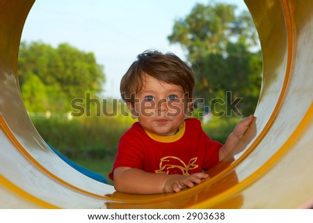 portrait of a young boy  getting busy on playground