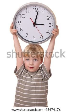 Portrait of a young boy holding a clock isolated on white background - stock photo
