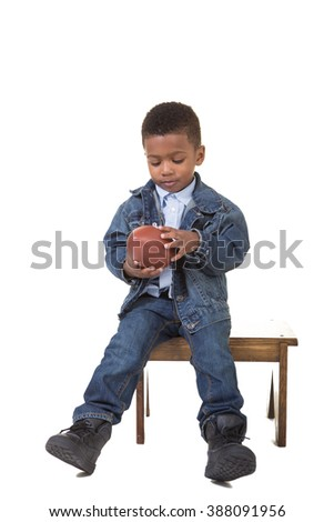 Portrait of a young boy holding a football - stock photo