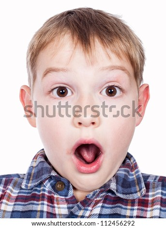 Portrait of a young boy's silly face - stock photo