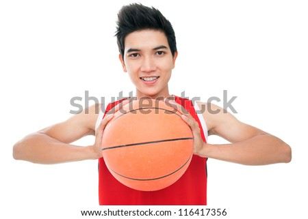Portrait of a young boy with basketball looking at camera and smiling - stock photo