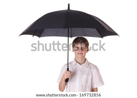 Portrait of a young boy with opened umbrella on white background - stock photo