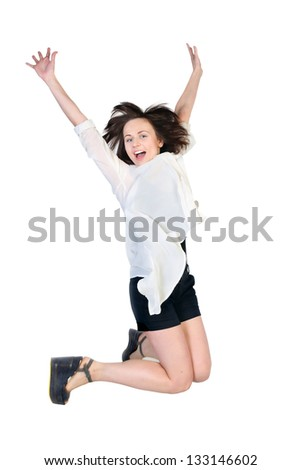 Portrait of a young brunette attractive woman in a jump. Isolated on white background. - stock photo