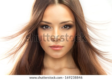 Portrait of a young brunette woman. Styled Fashion Portrait. Professional Make-up.Makeup