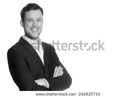 Portrait of a young business man in front of  white studio background, monochrome photo with copy space on the right side of the image - stock photo