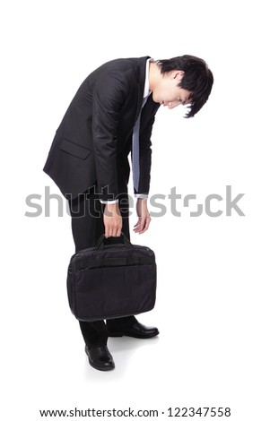 Portrait of a young business man looking depressed from work in full length isolated over white background, asian male model
