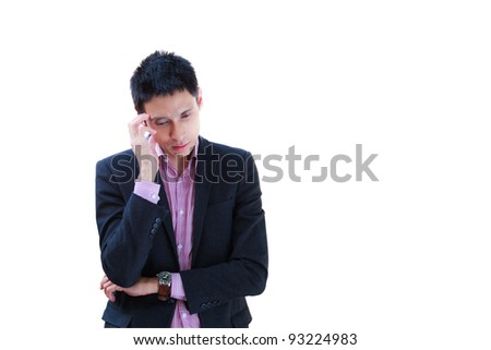 Portrait of a young business man looking depressed from work isolated over white background - stock photo