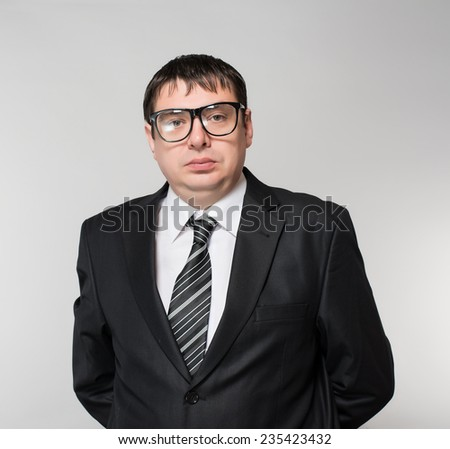 portrait of a young business man making a crazy smile, isolated on white - stock photo
