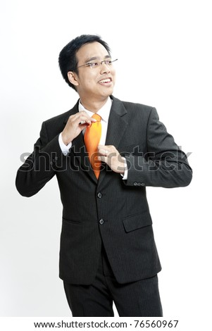 Portrait of a young business man pulling his collar on white background - stock photo