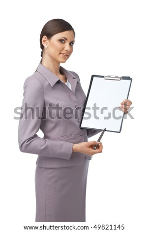 Portrait of a young business woman pointing with a pen on the paper she is holding - stock photo