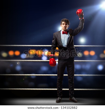 Portrait of a young businessman boxing. conceptual collage