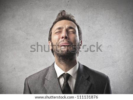Portrait of a young businessman crying - stock photo