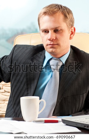 portrait of a young businessman in doubt about something - stock photo