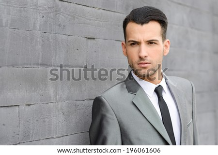 Portrait of a young businessman near a office building