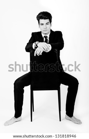 Portrait of a young businessman, on white background - stock photo
