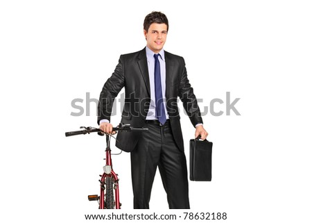 Portrait of a young businessman posing next to a bicycle isolated against white background - stock photo