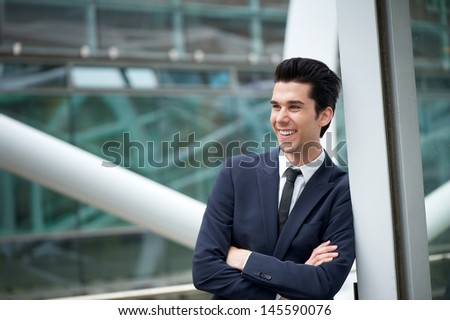Portrait of a young businessman smiling outdoors - stock photo