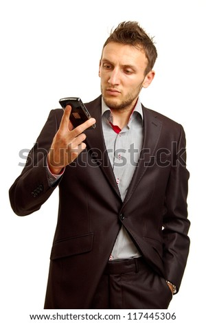 portrait of a young businessman talking on the phone, isolated on white