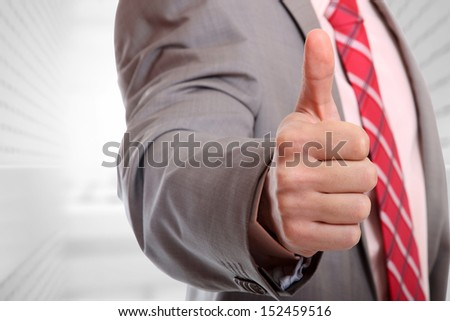 Portrait of a  young businessman, thumb's up - stock photo