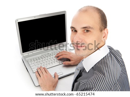 Portrait of a young businessman using laptop