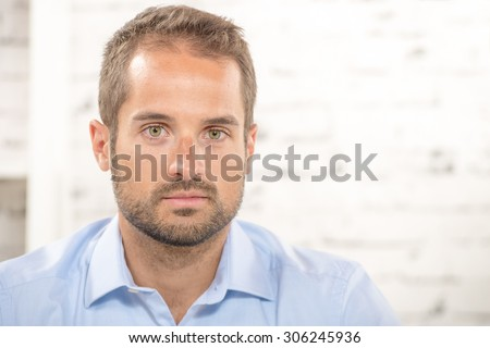 portrait of a young businessman with blue shirt - stock photo