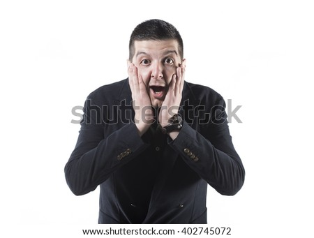 portrait of a young businessman with hands on his face looking surprised on a white background - stock photo