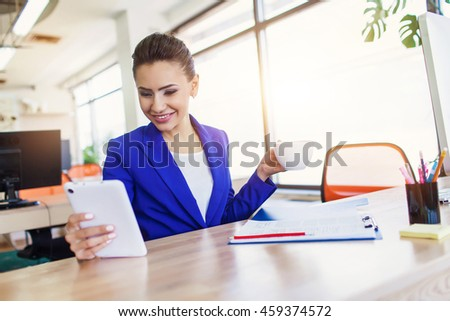 Portrait of a young businesswoman sitting at her office computer