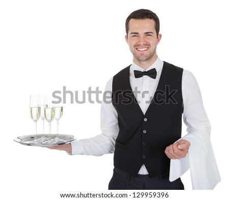 Portrait of a young butler with champagne glass. Isolated on white - stock photo