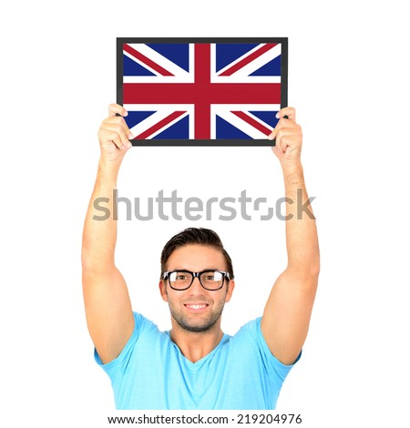 Portrait of a young casual man holding up board with National flag of Great Britain - stock photo