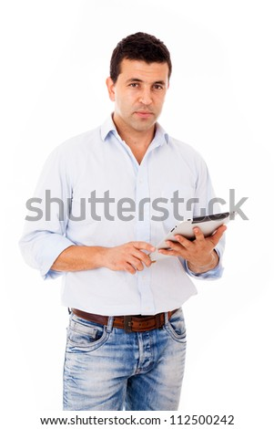 Portrait of a young casual man with a tablet computer against white background