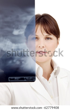 portrait of a young caucasian female doctor examining an X-ray