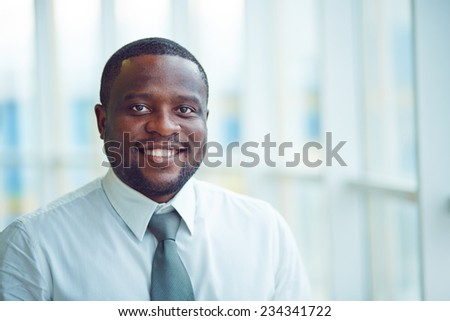 Portrait of a young cheerful businessman - stock photo