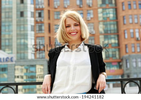 Portrait of a young cheerful stylish woman - stock photo