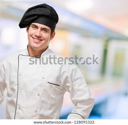 Portrait Of A Young Chef With Hand On Hip, indoor