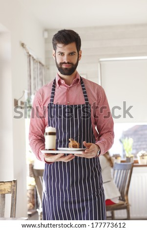 Portrait of a young coffee shop owner. - stock photo