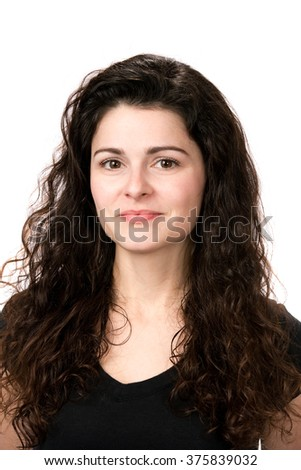 Portrait of a young confident businesswoman with dark curled hair. - stock photo