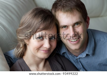 Portrait of a young couple at home - stock photo